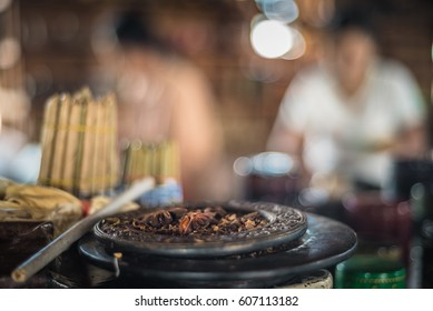 Making of traditional myanmar cigars and cigarettes at Inle lake workshop