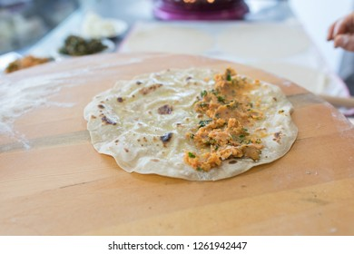 Making traditional Turkish borek or sikma with mashed potatoes. Borek or sikma yufka on the table. Traditional Turkish food culture or cuisine.
