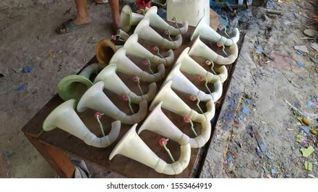 Making trumpet from fiberglass materials.  Traditional art from Bekasi, Indonesia.