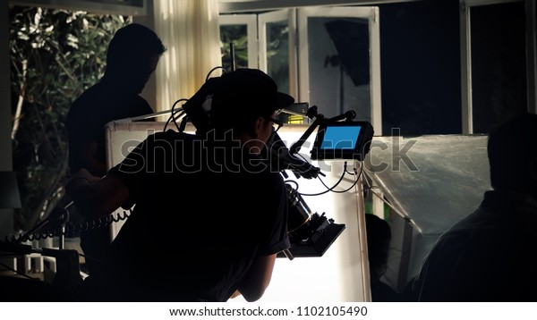 Making of TV commercial production in studio with professional equipment such as camera light tripod crane and crew team.