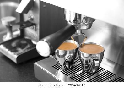 Making two espressos on stainless steel home espresso machine.