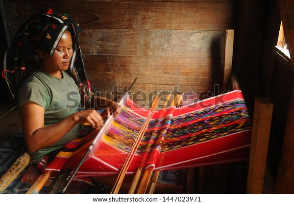 The Making Of Ulos (Ulos is Signatured Textile of Batak Culture) in Lumban Suhi-suhi Samosir Island, Lake Toba, North Sumatra, Indonesia. April 24, 2017