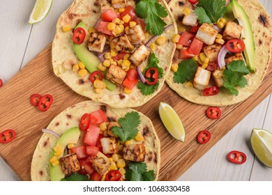 Making of vegetarian tacos. Mexican snack with tofu instead of meat. Healthy, nutritious and tasty food.