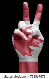 and making victory sign, Canada painted with flag as symbol of victory, win, success - isolated on black background