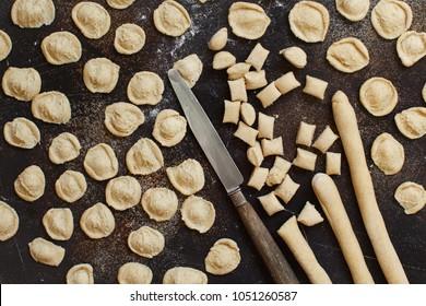 Making whole wheat flour pasta orecchiette from Puglia, Italy
