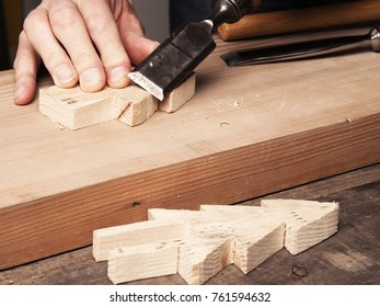 Making a wooden Christmas decoration tree with a chisel, wood working, Christmas concept