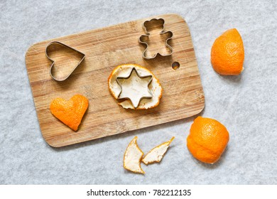 Making Xmas tree decoration from orange peels