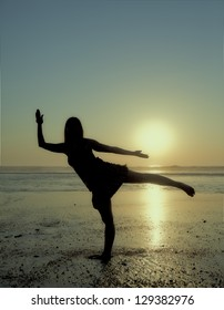 Making yoga on the beach