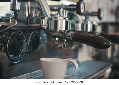 Making your brew at a time that suits your routine. Stainless steel coffee machine or coffeemaker. Coffee cup. Small cup to serve coffee or espresso drinks. Brewing coffee in commercial coffeehouse.