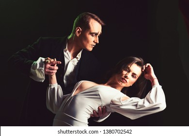 Making your heart flutter. Mime man and woman act in romantic scene. Couple of mime artists perform romance on stage. Theatre actors miming through body motions. Couple in love with mime makeup.