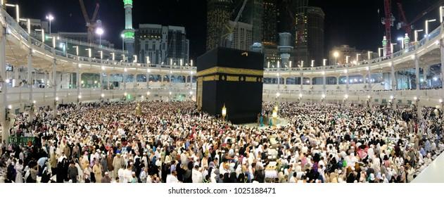 Makkah (Mecca), Saudi Arabia - circa May 2015 : Muslim pilgrims circumambulate the Kaaba at sunset at Masjidil Haram in Makkah. Muslims all around the world face the Kaaba during prayer time.