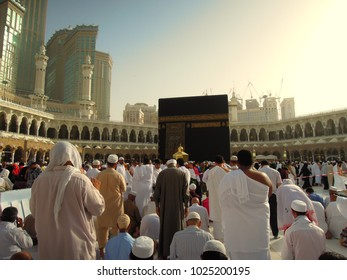 Makkah (Mecca), Saudi Arabia - circa May 2015: Muslim pilgrims circumambulate the Kaaba at sunset at Masjidil Haram in Makkah. Muslims all around the world face the Kaaba during prayer time.