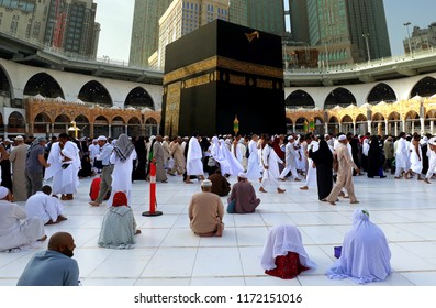 MAKKAH, SAUDI ARABIA - FEBRUARY 10, 2017: Muslim performing tawaf at holy Kaabah in the morning. Muslims face the direction of Kaaba when performing prayer