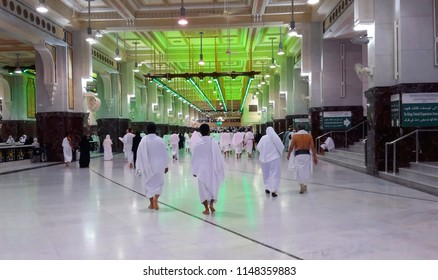 MAKKAH, SAUDI ARABIA - FEBRUARY 12, 2017: Group of Muslim worshipers is doing the saie starting from Safa to Marwah mountain, as one of the umrah and hajj process.