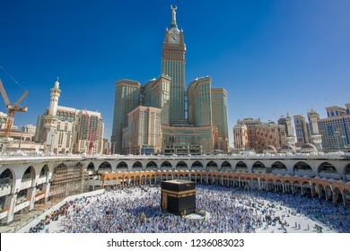 Makkah, Saudi ARABIA-April 2018: muslim prayer and tawaf for Abraj AL Bait  prophet Muhammad, kaabah, Saufi ARABIA,Makkah blue sky background.