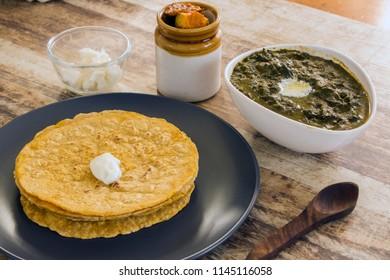Sarsonkasaagwith makki ki roti is a quintessential Punjabi dish, made from mustard greens (sarson) and Indian spices.