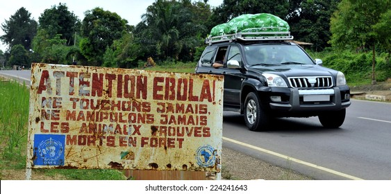 MAKOUA, CONGO, AFRICA - SEPTEMBER 27: Car and sign warns visitors that area is a Ebola infected. Signage informing visitors that it is a ebola infected area. September 27, 2013,Congo, Africa.
