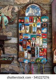 MAKRINITSA, PELION/GREECE - OCTOBER 8: Numerous souvenirs hang on old stone masonry shop wall on October 8, 2016 in Makrinitsa.