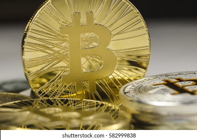 Makro detail of shiny gold Bitcoin coin
