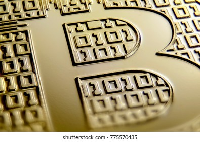 "Makro view of ""B"" sign on gold coin"