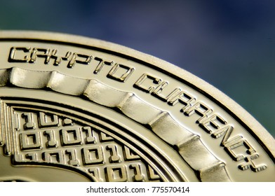 "Makro view of ""Crypto currency"" sign on gold coin"