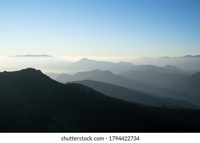 Mala Fatra and Velka Fatra in the distance, Slovakia, Europe - silhouette of mountains and hills in the morning. Hazy and misty nature and landscape.