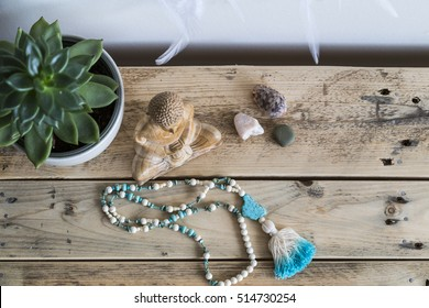 Mala and wooden buddha