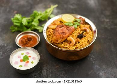 Malabar Chicken Biryani, hot spicy Chicken Dum Biriyani Kerala, India. Cooked Basmati rice traditional spices, meat for Ramadan, Eid. Top view North Indian non veg festival food dark black background. - Shutterstock ID 1721011360