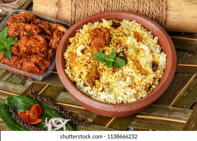 Malabar Chicken Dum Biryani and chilli chicken curry, Kerala India. Popular traditional dish hood made using basmati/saffron/jasmine rice, various other exotic Indian spices/masala