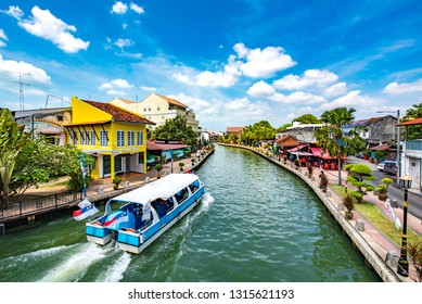 Malacca City, Melaka, Malaysia - February 5, 2019: Malacca River Cruise Navigating through the UNESCO World Cultural Heritage Site, a Historical Travel and Tourism Destination in Southeast Asia