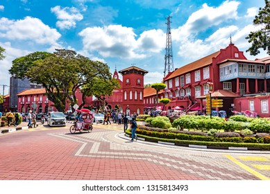 Malacca City, Melaka, Malaysia - February 5, 2019: Red Church, Clock Tower and Stadthuys on Dutch Square, Making Melaka a UNESCO World Heritage Site, a Historical Travel and Tourism Destination