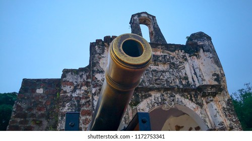 Malacca MALAYSIA - 02 SEPTEMBER 2018 : A Famosa fortress entrance with cannon pointing is a former Portuguese fortress. It is among the oldest surviving European architectural in Southeast Asia.