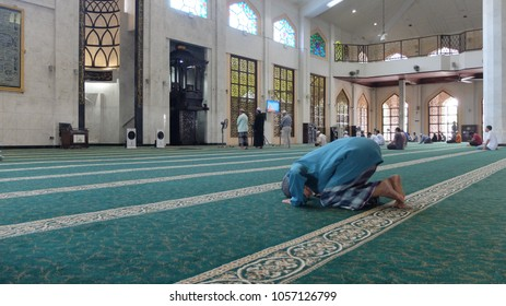 Malacca, Malaysia; 29/03/2018; A muslim man is performing prayer at Al Azim Mosque, Malacca, Malaysia.