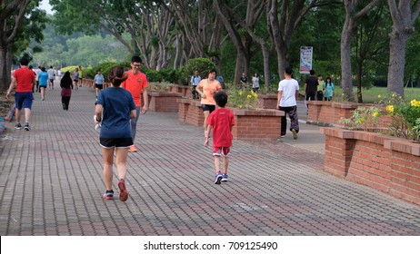 Malacca, Malaysia: 31/08/2017: Local people performing light exercise at Bukit Serindit Park, Malacca, Malaysia during weekday.
