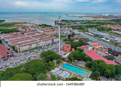 Malacca, Malaysia - 7 July 2019: Aerial View Of Taming sari Tower With Giant Ship Replica & Ocean View. Taming Sari Tower is a revolving gyro tower in Malacca City,
