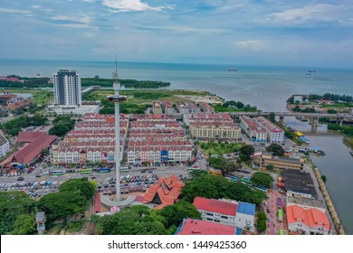 Malacca, Malaysia - 7 July 2019: Aerial View Of Taming Sari Tower With River Estuary And Ocean View. Taming Sari Tower is a revolving gyro tower in Malacca City, Malaysia.