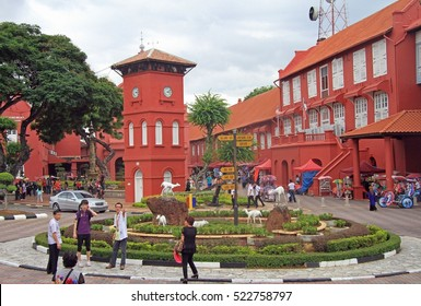 MALACCA, MALAYSIA - APRIL 10, 2015: people are walking by the Stadhuys Red Square in Malacca, Malaysia