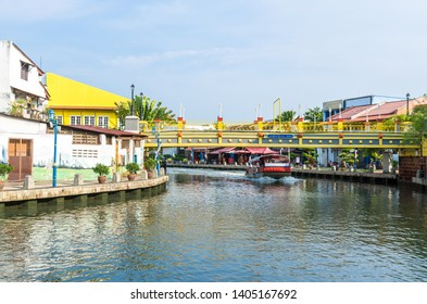 Malacca, Malaysia - April 21, 2019:  Riverside scenery of a cruise crossing by the Malacca River. It has been listed as UNESCO World Heritage Site since 7/7/2008.
