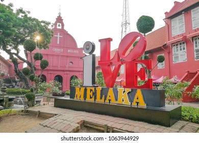 Malacca, Malaysia, April 8, 2018: Malacca city is awarded the UNESCO World Heritage City status. Featured here is Dutch Square, popular tourism destination with historic red color buildings.