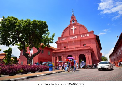 MALACCA, MALAYSIA - AUG 7, 2015: Day view of Christ Church & Dutch Square in Malacca City, Malaysia. It was built in 1753 by Dutch & is the oldest 18th century Protestant church in Malaysia.