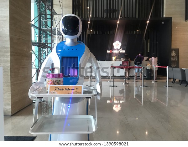 Malacca, Malaysia- Circa April 2019. Swiss garden Malacca using robot to welcome guests and served cookies at entrance hotel lobby.