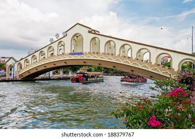 MALACCA, MALAYSIA - DEC 19, 2013: An arch bridge over the Malacca river near Jambatan Old Bus Station. Malacca City was listed as a UNESCO World Heritage Site on 7 July 2008