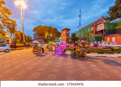 MALACCA, MALAYSIA - DECEMBER 23: Decorative trishaw at Malacca city on Dec 23, 2013 in Malacca, Malaysia. Malacca has been listed as a UNESCO World Heritage Site since 7 July 2008.