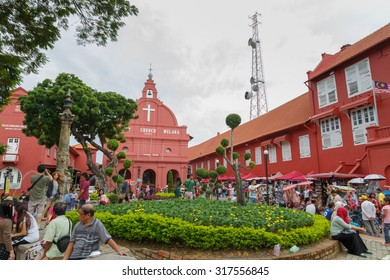 MALACCA, MALAYSIA -December  28, 2014: Day view of Christ Church & Dutch Square in Malacca City, Malaysia. It was built in 1753 by Dutch & is the oldest 18th century Protestant church in Malaysia.