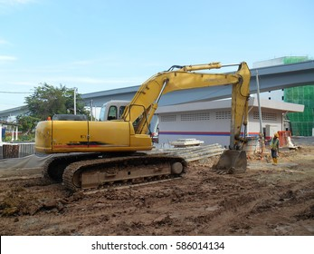 MALACCA, MALAYSIA -FEBRUARY 16, 2017: Excavators machine is heavy construction machine used excavate soil during construction. Powered by long hydraulic arm with bucket.