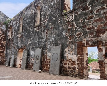 Malacca, Malaysia-- February 2018: Old Portugese tombstones lined up on the walls of St. Paul's Church ruins in Malacca City.