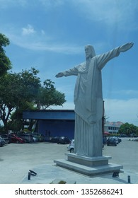 Malacca, Malaysia-- February 2018: Side upward angle of the Jesus Christ Statue at the Portugese Settlement in Malacca City.