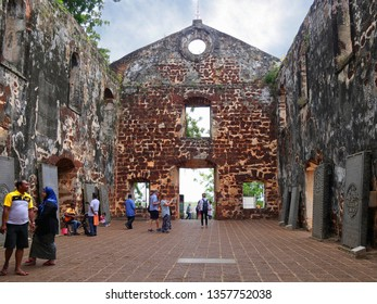 Malacca, Malaysia-- February 2018: Wide shot of the ruins of St. Paul's Church with tourists in Malacca City.