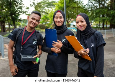 Malacca, Malaysia - February 28, 2019: Young pupils smile for the camera.