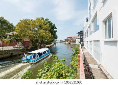 MALACCA, MALAYSIA - FEBRUARY 6, 2018: Pleasure boat sailing on the river in Malacca. Tourists on board are enjoying a sightseeing cruise on the river.  Malacca is a UNESCO World Heritage site.